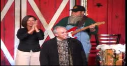 Mark Trammel sings at the Comedy Barn
